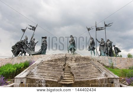 TULLN, AUSTRIA - JUN 3, 2016: Sculptures over the Nibelungen Fountain dedicated to the heros of The Song of the Nibelungs on June 3, 2016. Tulln on the Danube city has population near 16000