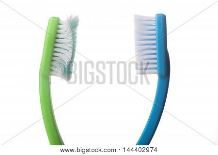 Used old tooth brush and new tooth brush on a white background