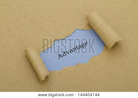 Advantage word written under torn paper .