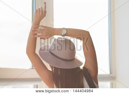 Beautiful boho woman in a wool hat standing in the summer sun