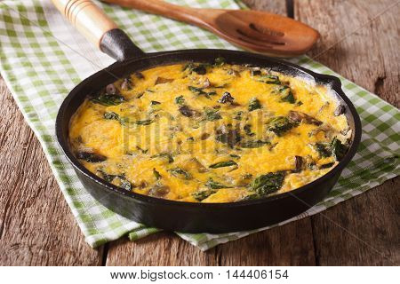Hot Scrambled Eggs With Spinach, Cheddar Cheese And Mushrooms In A Frying Pan. Horizontal