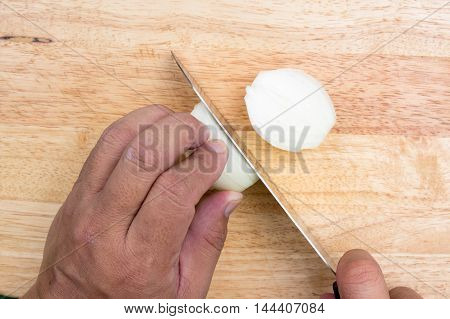 Chef slicing onion on wooden broad / cooking Baked spinach concept