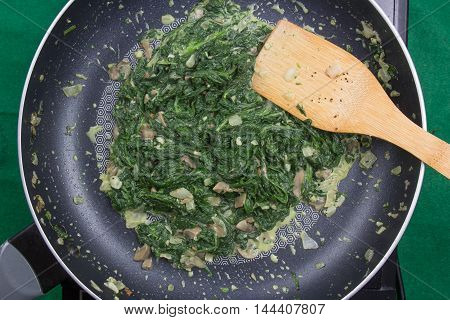 spinach cooking in pan / cooking Baked spinach concept