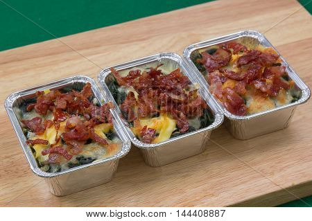 Baked cheese spinach in box / cooking Baked spinach concept