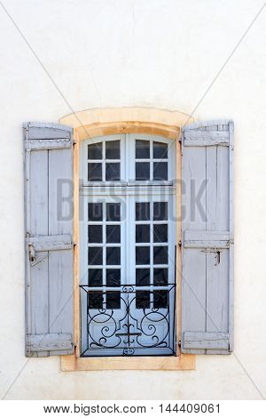 Picturesque window in historic center of Avignon, Provence