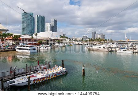 Miami USA - November 25 2011: Bayside Entertainment Market Place and Marina on a nice warm autumn day with the American Airlines Arena in the background at November 25 2011.