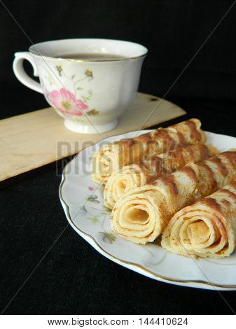 Dessert With Rolled Pancakes And Cup Of Tea Perfect Party Idea