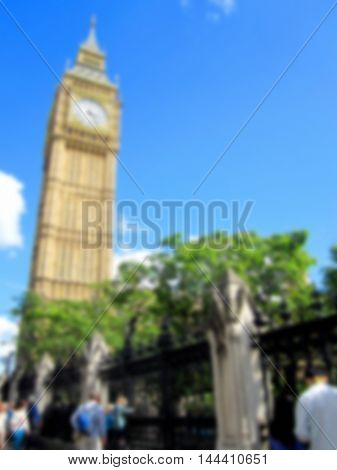 Blurred Big Ben on blue sky and tourists sightseeing background