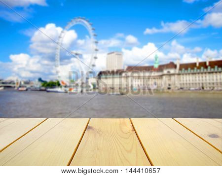Wooden table on blurred London scenery background