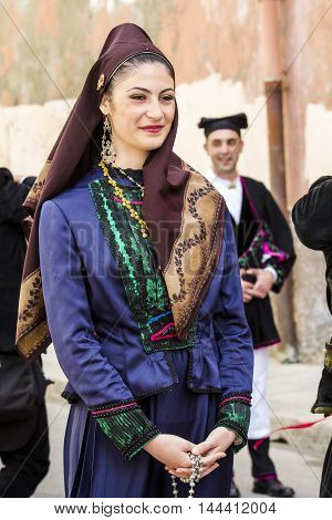 CAGLIARI, ITALY - May 1, 2016: 360 ^ Sant'Efisio Festival - Sardinia - portrait of a beautiful girl in traditional Sardinian costume