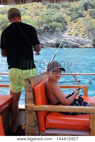 A father and son on a fishing trip in turkey, 2016