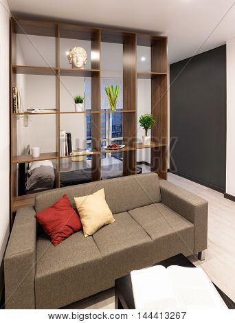 Living room in modern apartment at evening