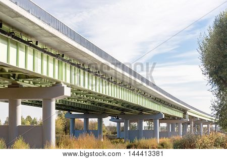 Perspective view of an overpass during summer day.