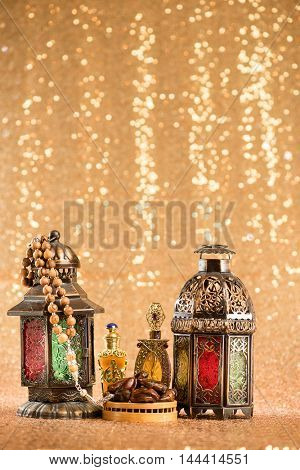 Eid and Ramadan theme background with Arabic lanterns and dates on a gold background