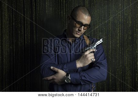 Brutal strong man with a gun Caucasian appearance