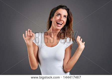A beautiful young woman feeling happy smiling