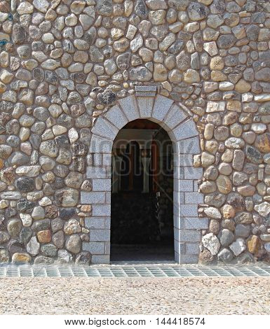 Stone House Exterior Facade With Arch Doorway