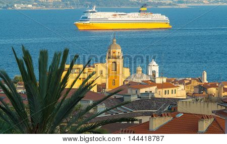 The houses of Ajaccio city Corsica island and ferryboat in the background.