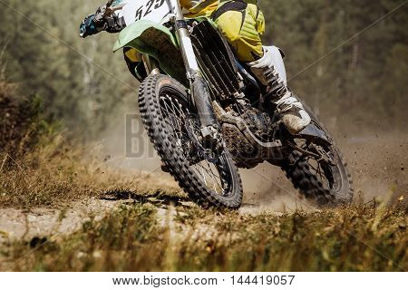 closeup of a rider on a race bike during a competition in motocross