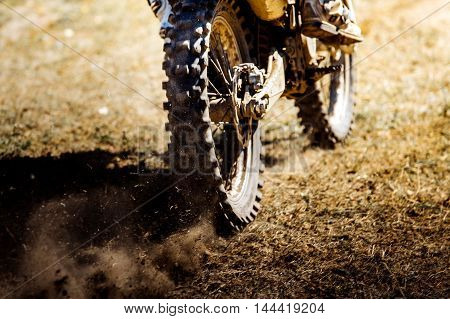 rear wheel of a sports bike dust and dirt from under wheels