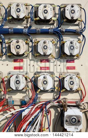 Old electrical metal control panel with switches.