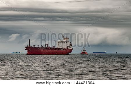 Ship at sea against a dramatic sky.