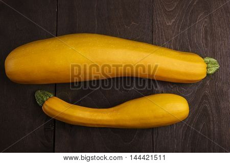 Harvested big and medium zucchini. Fat and thin.Close up background.Horizantal shot.Rustic bakground