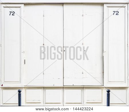Antique White Wooden Doors Of A Store.