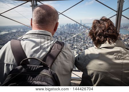 NEW YORK USA - Apr 30 2016: Tourists enjoying the breathtaking views of New York City from the observation deck of Empire State Building