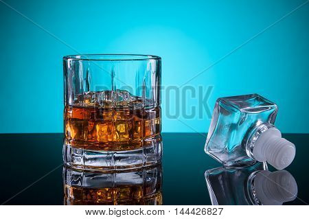 Glass of alcohol and the stopper. A close up of a glass of liquor with the bottle stopper.