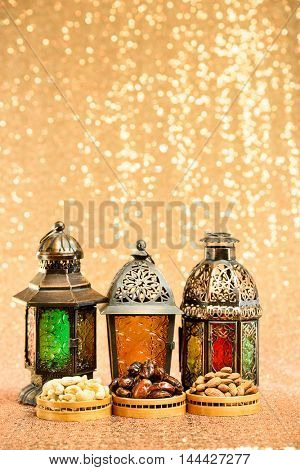 Eid and Ramadan themed backgrounds with traditional Arabian Lamps with Dates and nuts