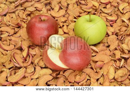 ripe apples on a background of dried fruit