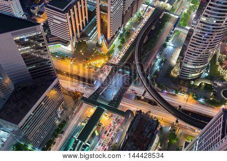 Aerial view Bangkok city road intersection, long exposure, Thailand