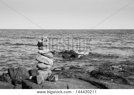 Black and White, Pile of beautifully stacked stones with ocean natural background