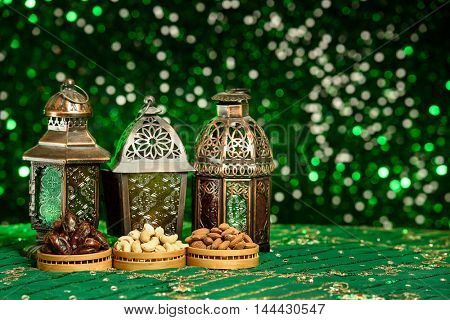 Eid and Ramadan themed backgrounds with traditional Arabian Lamps and green glitter background