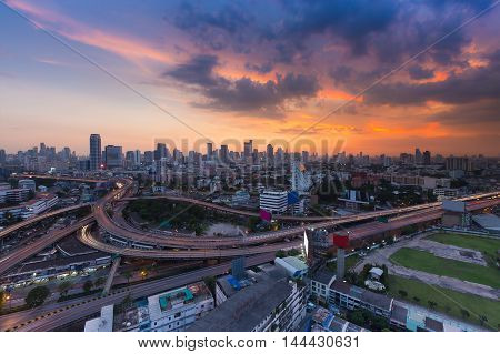 Aerial view cityscape and highway with sunset sky background