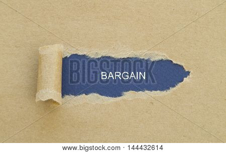 BARGAIN word written under torn paper .
