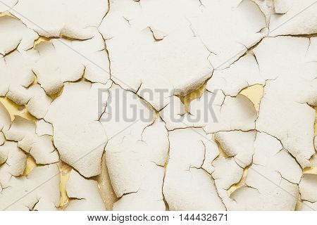 abstract view of old peeling paint with dark edges and cracks to be used as a background