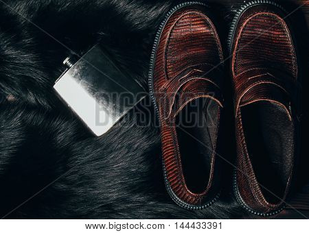 Mocasine Shoes Of Snake Skin And Stainless Flask On The Fur. F