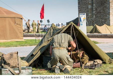 American Soldiers Sit In Their Tent Tactics