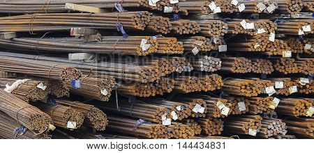 Steel rods or bars used to reinforce concrete for construction.