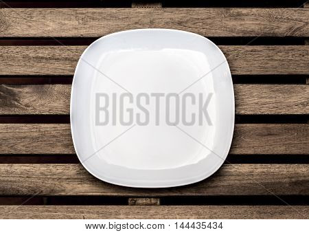the Empty white plate on wooden background