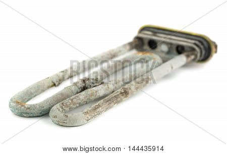 Broken heating element of water heater with scum and sediment isolated on white background