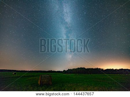 summer field and milky way on night sky, abstract natural background.