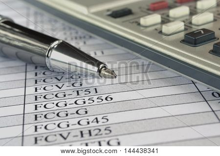 Business background with table pen and calculator.