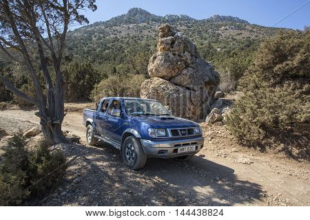 Acamas Cyprus Iune 07 2016: SUV along a dirt road in the desert landscape of the Acamas Nature Reserve in Cyprus