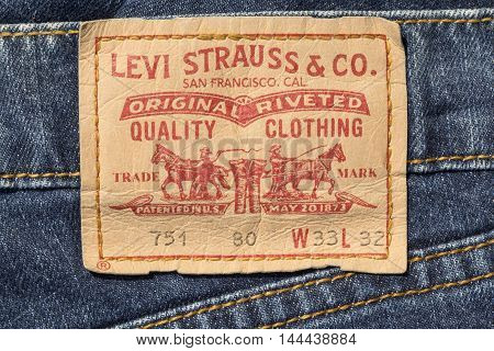 Chisinau Moldova - August 19 2016: Closeup of Levi's leather jeans label sewed on a blue jeans isolated on white background.Levi Strauss & Co is a privately held American clothing company.