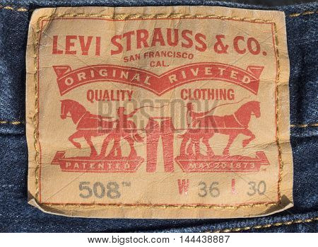 Chisinau Moldova - JAugust 19 2016: Closeup of Levi's jeans label. Levi Strauss is a private company produced jeans.