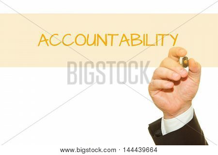 Businessman hand writing Accountability with a marker.