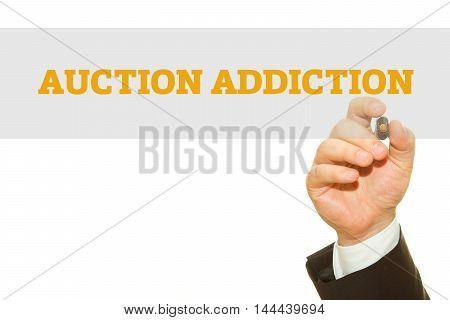 Businessman hand writing Auction Addiction isolated on white.